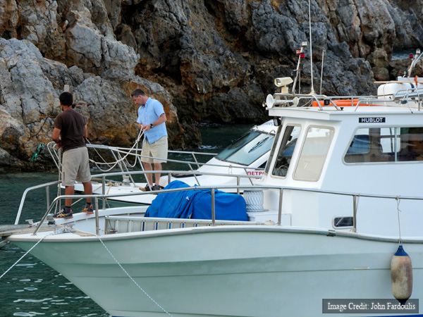 Alexander Sotiriou & Brendan Foley adjusting mooring lines on the two dive boats, ready for heavy weather.