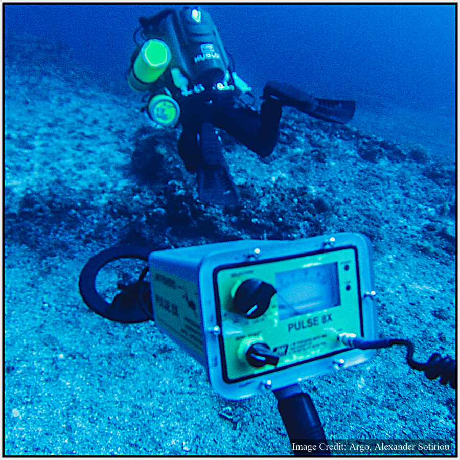 Conducting a metal detector survey of the Antikythera wreck site.
