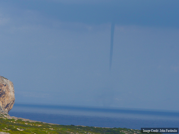 A water spout, seen from the near the village of Potamos in Antikythera