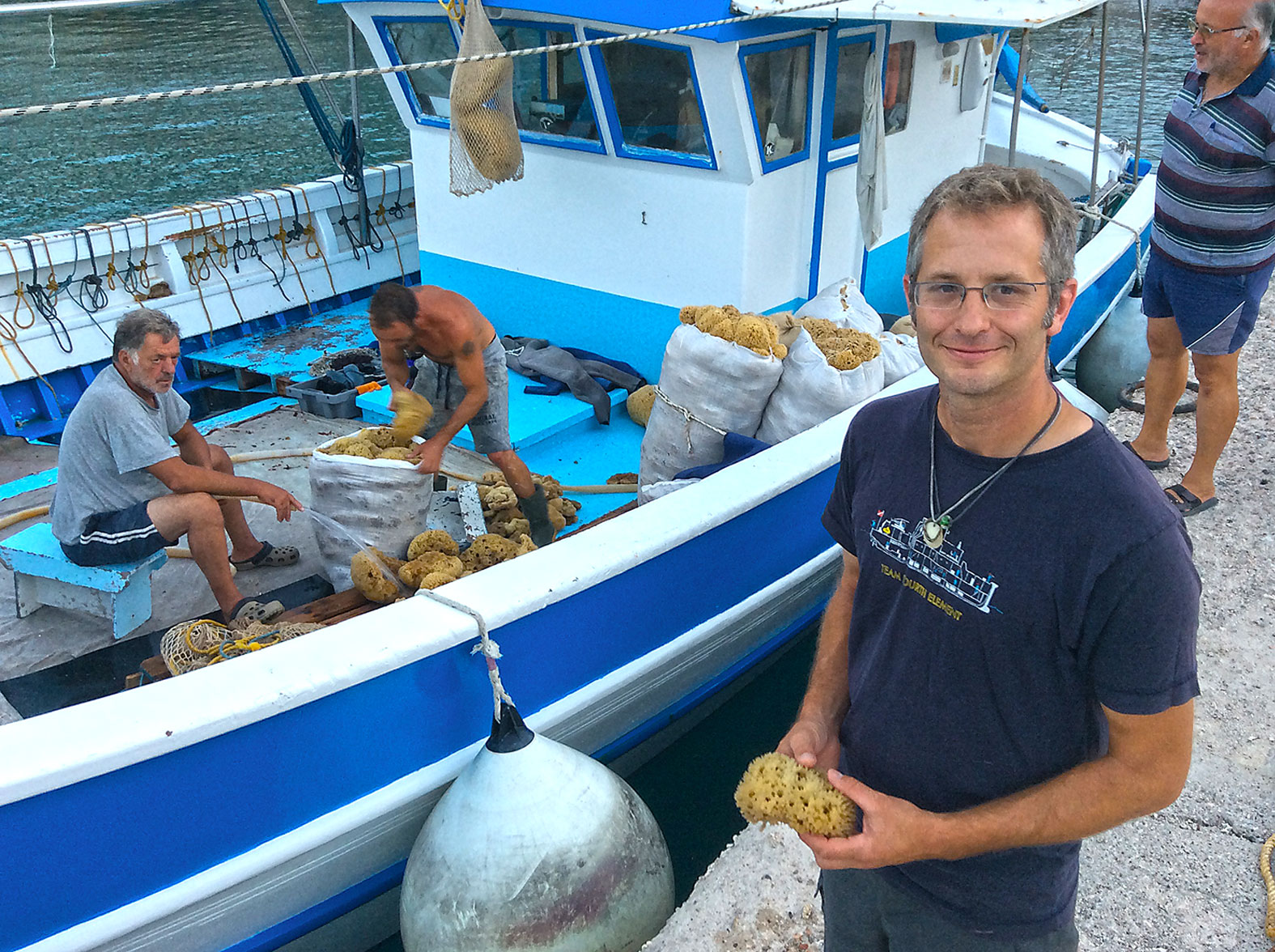 The whole dive team was excited about sponge diving techniques of the past. Here's Evan Kovacs with a locally harvested sponge to take back to the USA as a present.