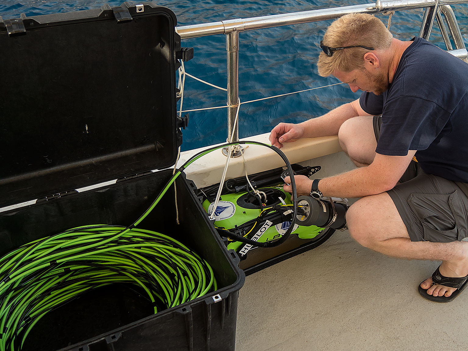 Dr. Carl Kaiser preparing the ROV, which provides a live video feed to the surface.